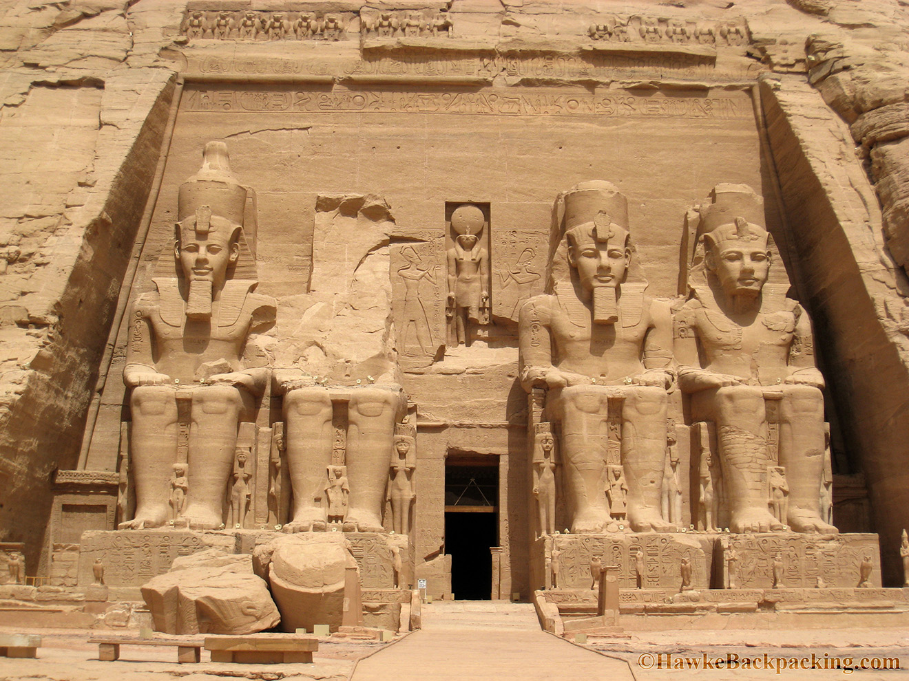 abu simbel Abu simbel is a temple complex, originally cut into a solid rock cliff, in southern egypt and located at the second cataract of the nile river the two temples which comprise the site (the great temple.
